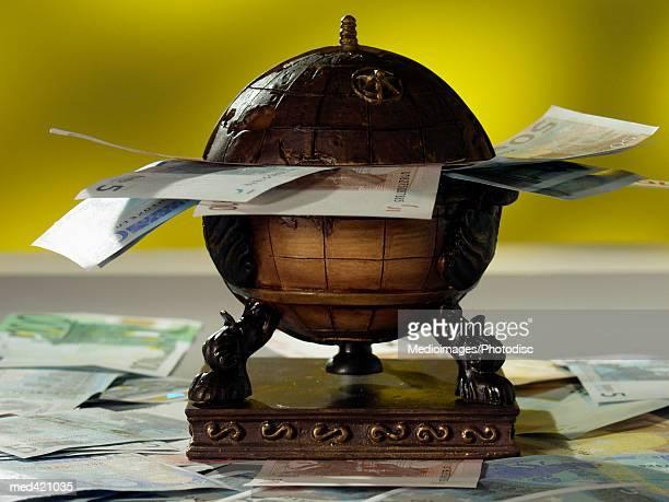 Euro bank notes on a globe
