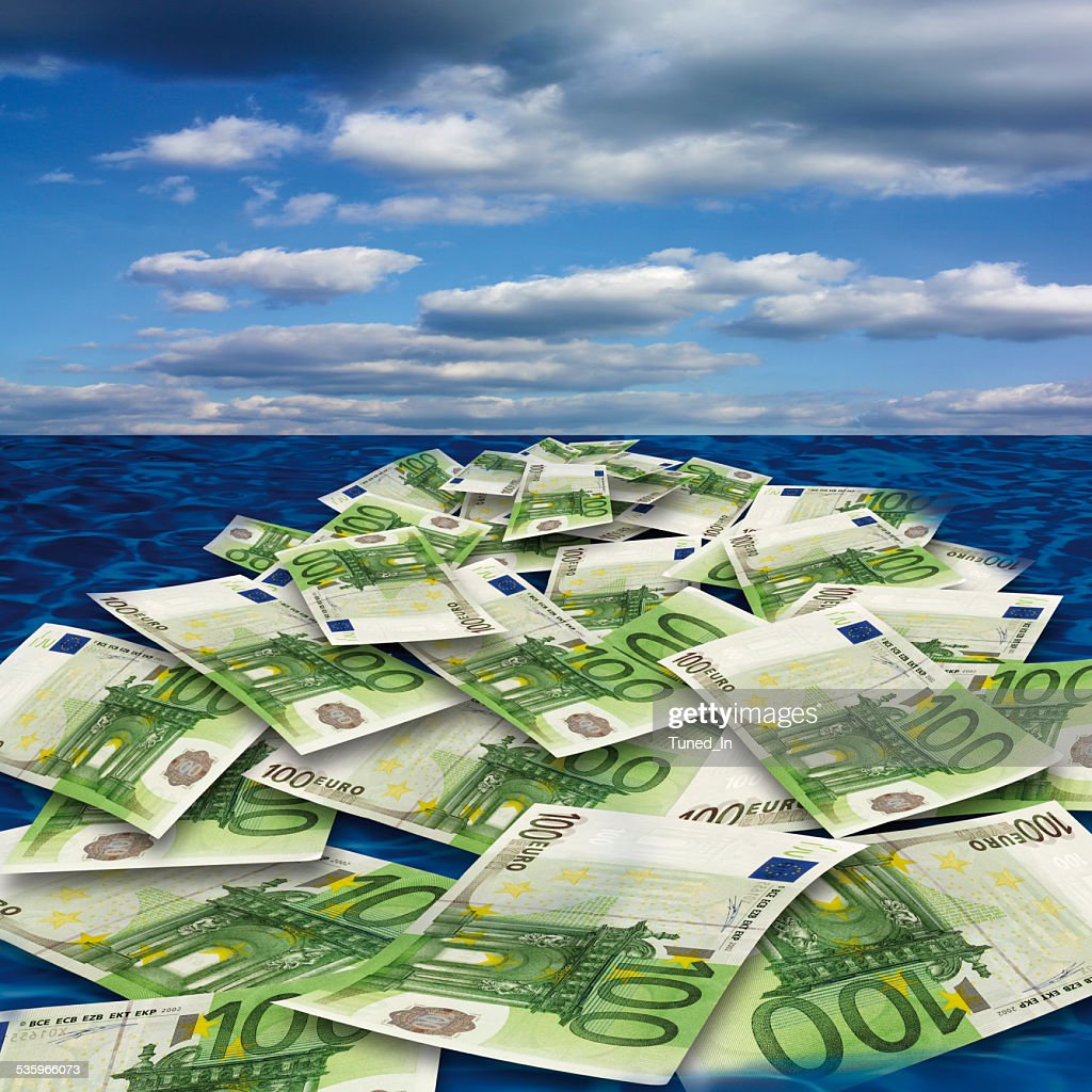 100 euro banknote floating on sea, close-up : Stock Photo