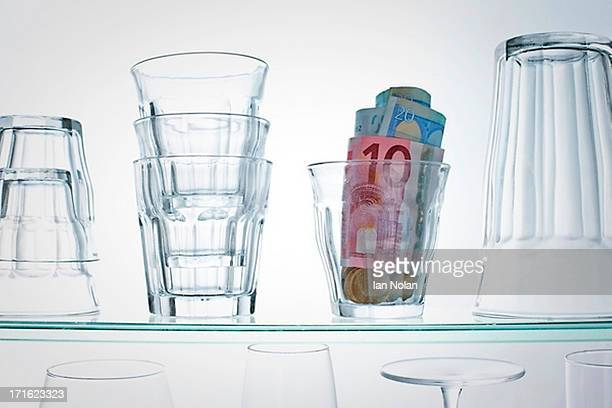 Euro banknotes in glass on shelf