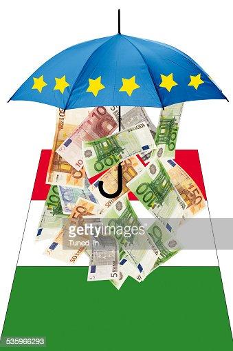 Euro banknotes under umbrella with italian flag : Stock Photo