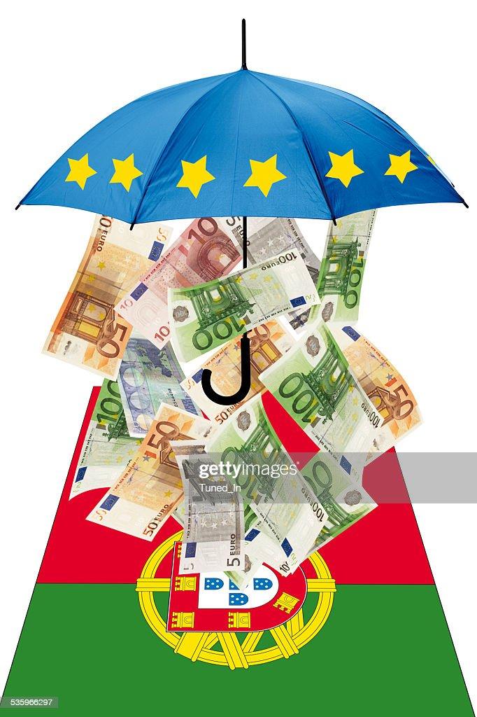 Euro banknotes under umbrella with portuguese flag : Stock Photo