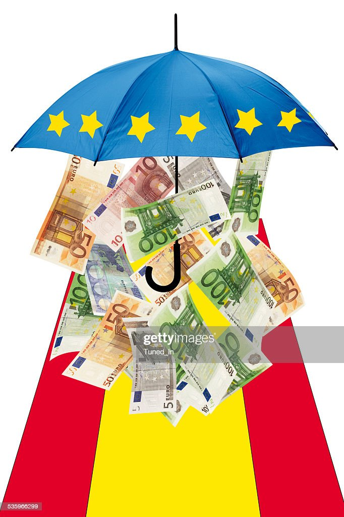 Euro banknotes under umbrella with spanish flag : Stock Photo