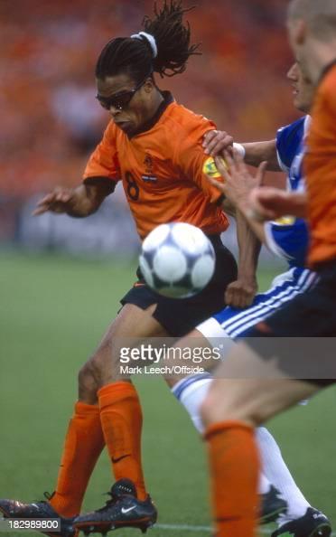 Euro Championships 2000 Netherlands v Yugoslavia Edgar Davids of the Netherlands holds off a Yugoslavian defender while Jaap Stam of the Netherlands...