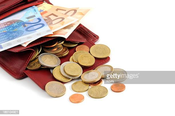 Euro coin and paper currency falling out of wallet