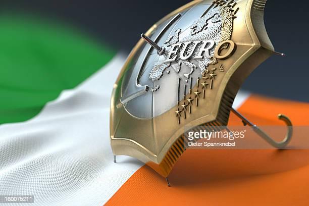 Euro coin designed umbrella on a flag of Ireland