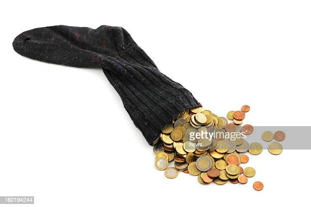 Euro coin falling out of money sock