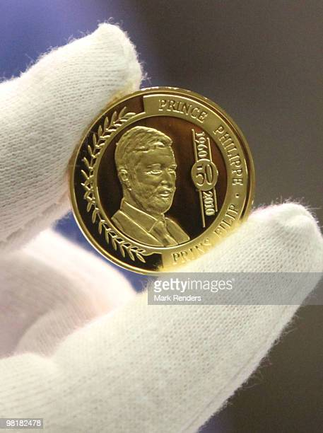 A 100 euro coin struck with a picture of Prince Philippe of Belgium is seen at Belgiums Royal Mint on April 1 2010 in Brussels Belgium The golden 100...