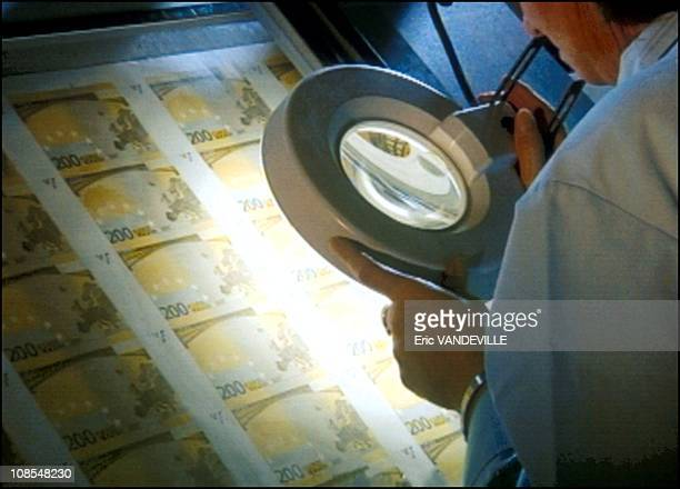 Euro coins and bills manufacturing in Rome Italy in November 2001