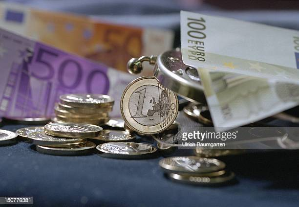 Euro coins and Euro notes at a purse