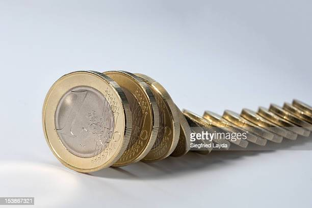 Euro coins in domino effect
