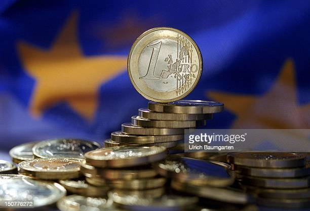Euro coins in front of the Europe flag
