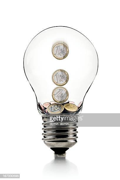 Euro coins in light bulb, savings symbol, isolated on white