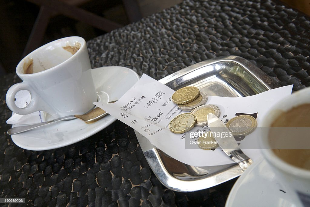 Euro coins left to pay for a coffee at a cafe : Stock Photo