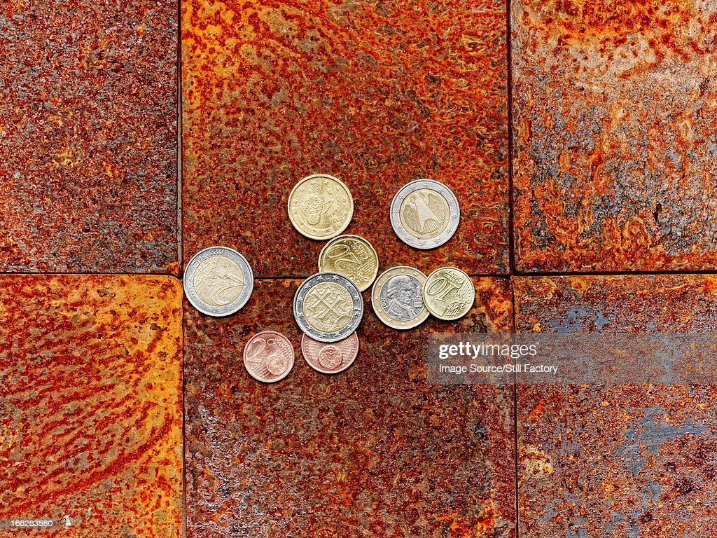 Euro coins on brick floor : Stock Photo