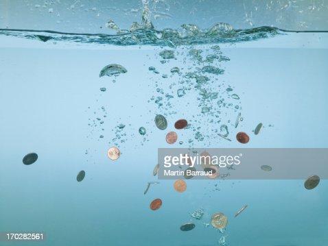 Euro coins splashing in water : Stock Photo