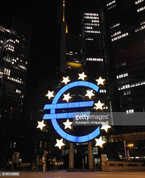 Euro Currency symbol in Frankfurt Financial District  at night