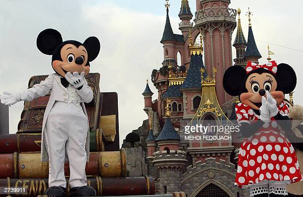 WITH 'MICKEY TURNS 75' Euro Disney employees wearing Mickey Mouse and Minnie costums parade 18 November 2003 while celebrating the famous mouse's 75...
