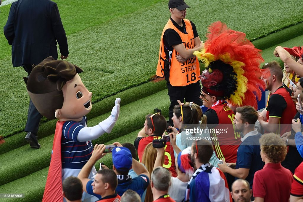 Euro mascot Super Victor greets the fans during the Euro 2016 round of 16 football match between Hungary and Belgium at the Stadium Municipal in Toulouse on June 26, 2016. / AFP / Pascal PAVANI