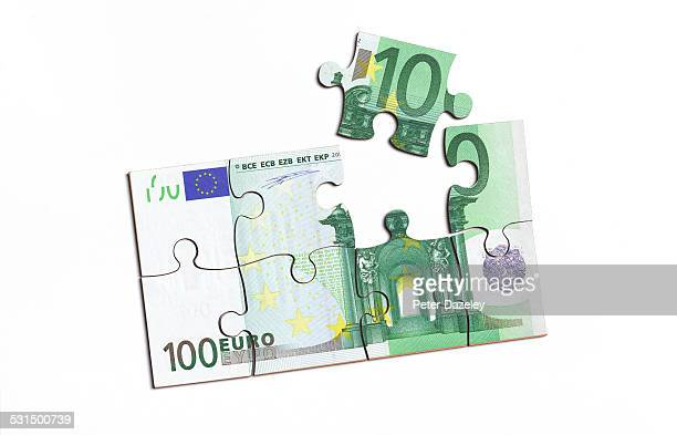 Euro note with jigsaw piece