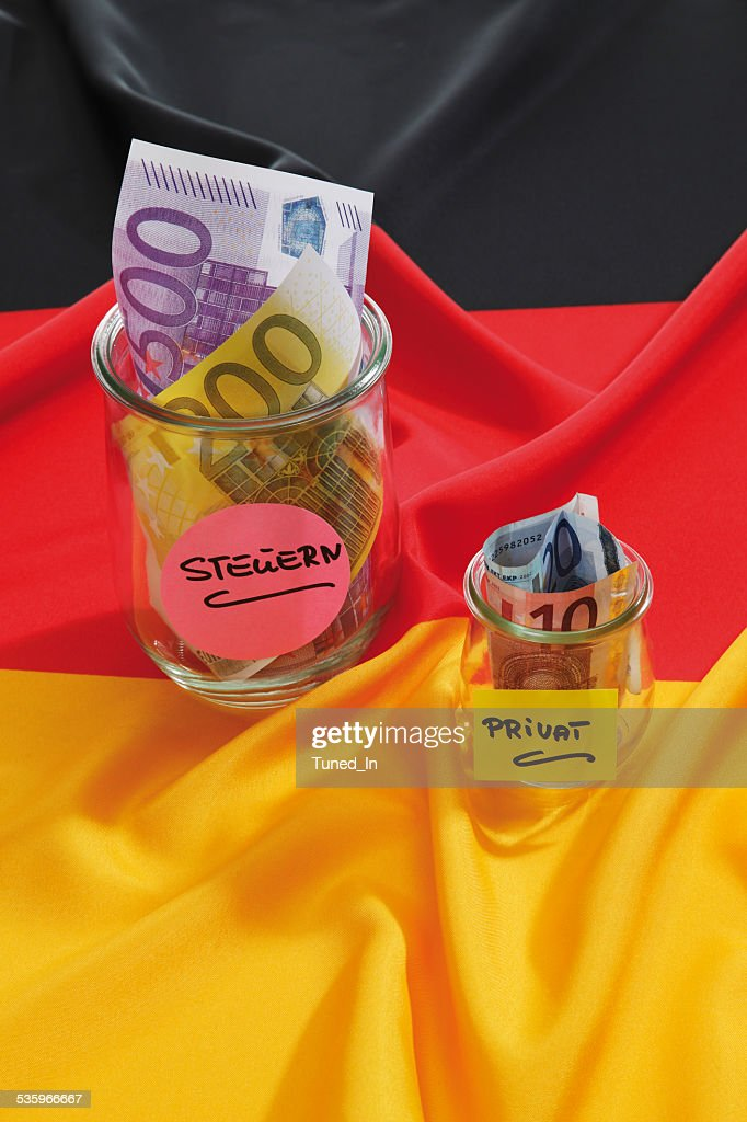 Euro notes in container on german flag : Stock Photo
