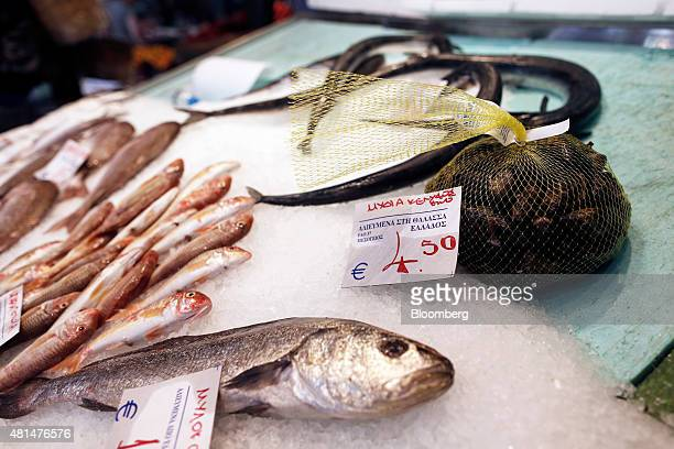 A euro price sign sits on a bag of fresh mussels on a fishmonger's stall at Kapani market in Thessaloniki Greece on Tuesday July 21 2015 Greece's...