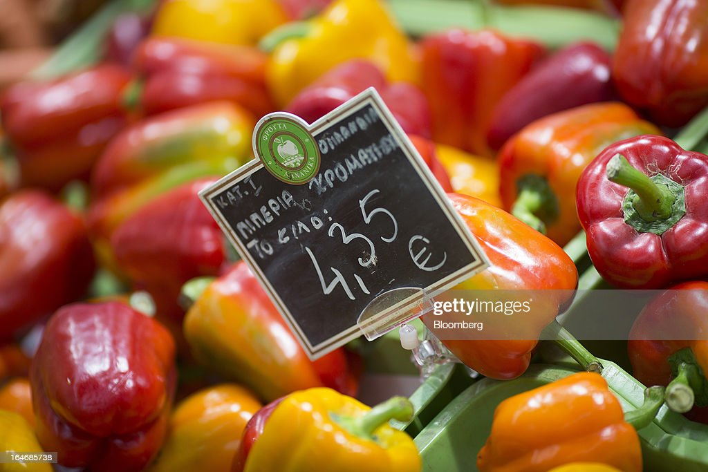 A euro price sign sits on a display of fresh peppers inside a Carrefour SA supermarket at the Mall of Cyprus in Nicosia, Cyprus, on Tuesday, March 26, 2013. Controls on capital movements to prevent money from draining out of the banking system -- allowed in exceptional circumstances under European Union law -- will remain for 'a matter of weeks,' Cypriot Finance Minister Michael Sarris said. Photographer: Simon Dawson/Bloomberg via Getty Images