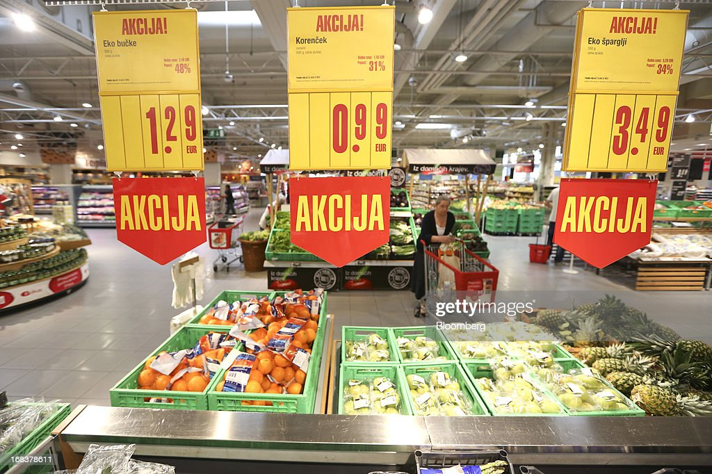 Euro price signs hang above fresh fruit for sale in the grocery department of a Mercator Poslovni Sistem d.d. supermarket in Ljubljana, Slovenia, on Wednesday, May 8, 2013. In January Mercator reported its first full-year loss in fifteen years as the largest supermarket chain's sales in the Balkans last year suffered during the recession. Photographer: Chris Ratcliffe/Bloomberg via Getty Images