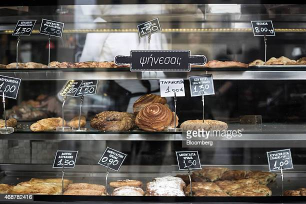Euro price signs sit beside pastries for sale in the shop window of a bakery in Thessaloniki Greece on Monday April 6 2015 Prime Minister Alexis...
