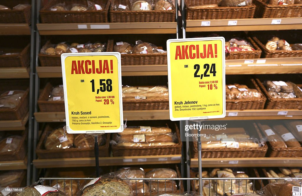 Euro price signs stand near bread baskets in the bakery section of a Mercator Poslovni Sistem d.d. supermarket in Ljubljana, Slovenia, on Wednesday, May 8, 2013. In January Mercator reported its first full-year loss in fifteen years as the largest supermarket chain's sales in the Balkans last year suffered during the recession. Photographer: Chris Ratcliffe/Bloomberg via Getty Images