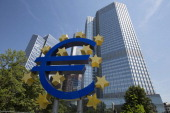 A euro sign sculpture is seen in front of the headquarters of the European Central Bank in Frankfurt Germany on Thursday July 3 2014 European Central...