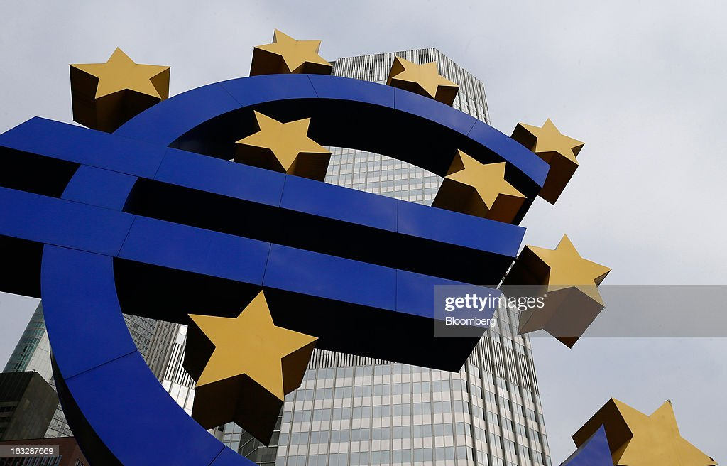 A euro sign sculpture stands outside the European Central Bank (ECB) headquarters in Frankfurt, Germany, on Thursday, Mar. 7, 2012. The European Central Bank left interest rates on hold as it gauges how big a threat Italy poses to the economic recovery. Photographer: Ralph Orlowski/Bloomberg via Getty Images