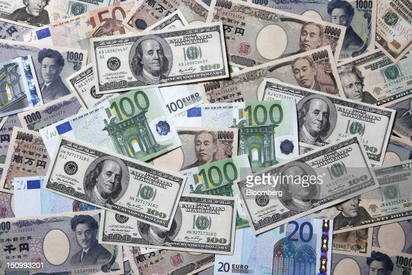 Euro yen and US dollar banknotes of various denominations are arranged for a photograph in Soka City Saitama Prefecture Japan on Wednesday Aug 29...