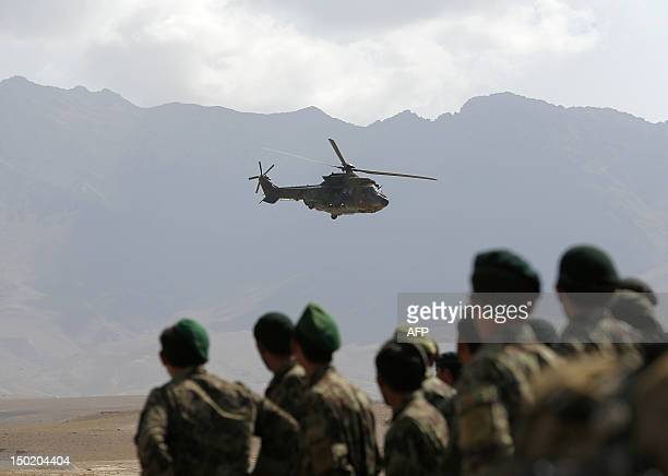 A Eurocopter AS 532 Cougar helicopter of the French Helicopter Battalion 'Mousquetaire' flies as soldiers of the Afghan National Army watch trainings...