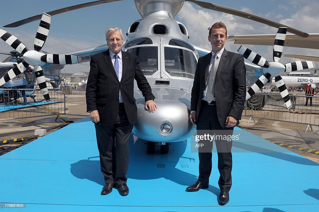Eurocopter Chairman Guillaume Faury (R) and EADS member of the Board of Director Jean-Claude Trichet pose in front of the Eurocopter X3 at Le Bourget airport, near Paris on June 20, 2013 during the 50th International Paris Air show.
