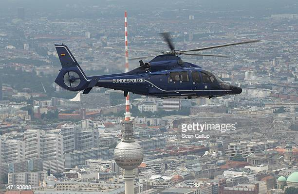 Eurocopter EC 155 helicopter of the Bundespolizei the German federal police force flies over the brodcast tower at Alexanderplatz on June 27 2012...