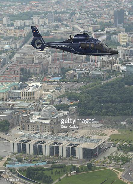Eurocopter EC 155 helicopter of the Bundespolizei the German federal police force flies over the Reichstag and government quarter on June 27 2012...