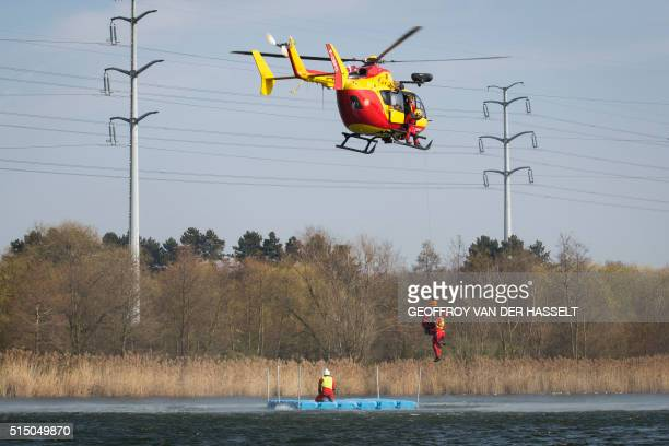 A Eurocopter EC145 'Dragon' helicopter of the Department of Civil Defence and Emergency Preparedness winches up a rescuer and a rescued person during...