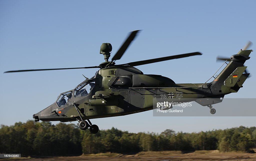 A Eurocopter Tiger combat helicopter flies during the annual military exercises held for the media at the Bergen military training grounds on October 2, 2013 near Munster, Germany. The Bundeswehr is transitioning to a professional army as Germany recently ended mandatory military service.
