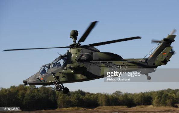 Eurocopter Tiger combat helicopter flies during the annual military exercises held for the media at the Bergen military training grounds on October 2...