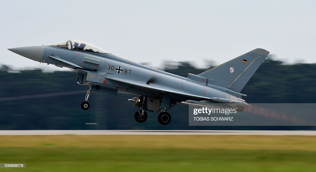 A Eurofighter aircraft takes off at the International Aerospace Exhibition (ILA) in Schoenefeld on May 30, 2016. The Aerospace Exhibition at Schoenefeld Airport near Berlin takes place from June 1 till 4. / AFP / TOBIAS