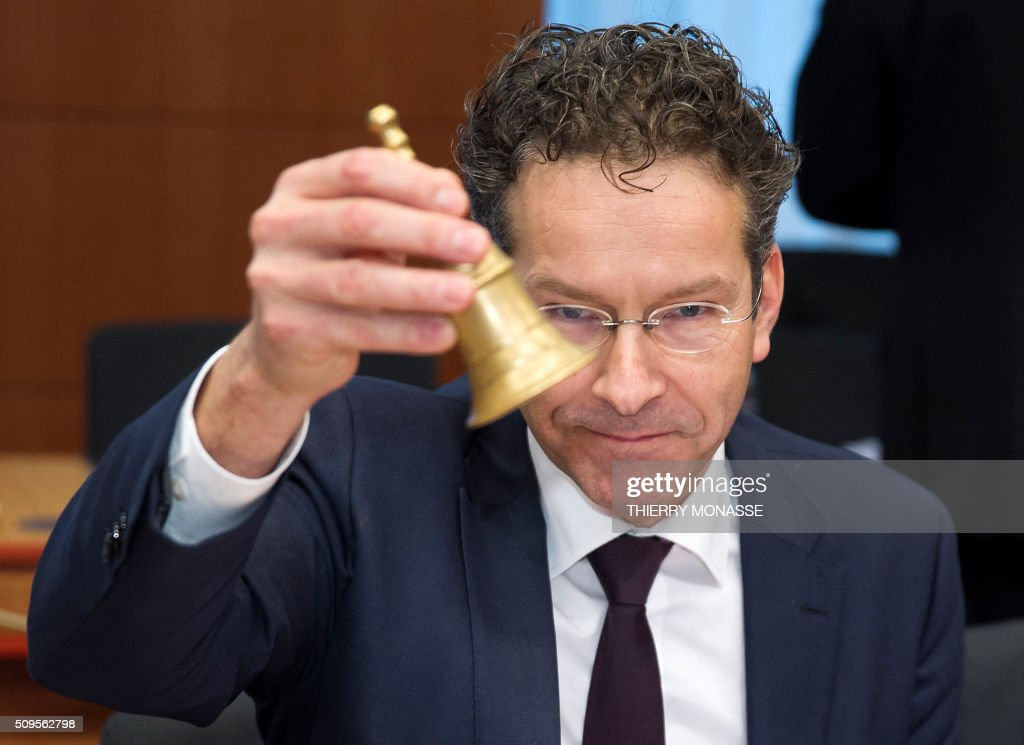 Eurogroup President and Dutch Finance Minister Jeroen Dijsselbloem rings the bell prior to a meeting of Eurogroup ministers at the European Council headquarters in Brussels on February 11, 2016. / AFP / THIERRY MONASSE