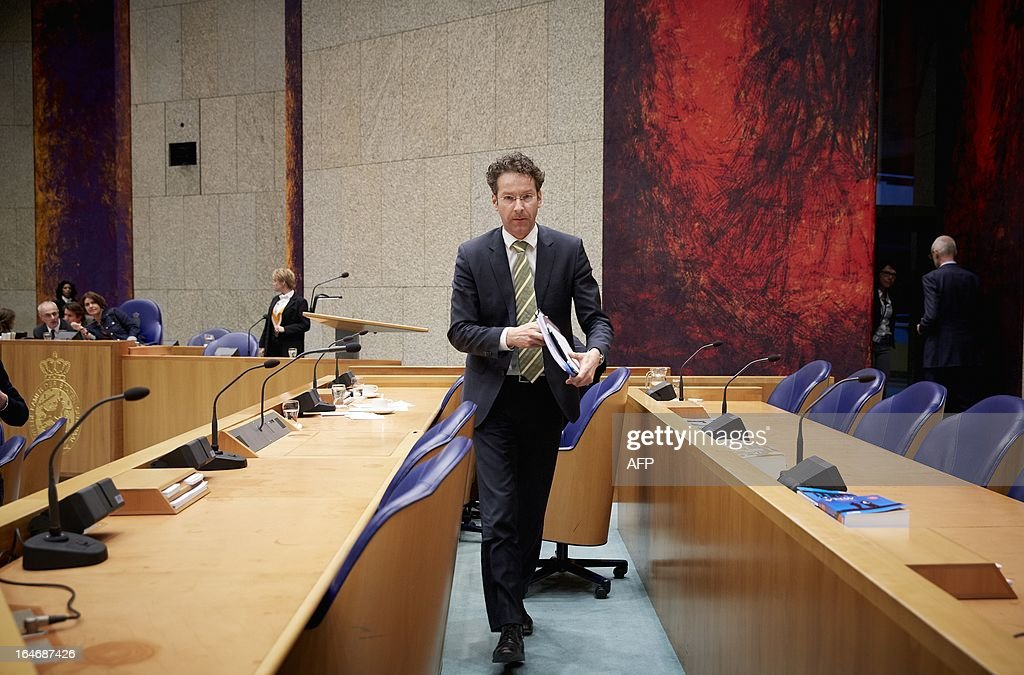 Eurogroup President Dutch Finance Minister Jeroen Dijsselbloem arrives for a debate on the convention of the aid to Cyprus at the Senate (Tweede Kamer) at the Binnenhof in The Hague on March 26, 2013. The Cyprus debt rescue and its 'bail-in' provision to make large bank depositors pay part of the cost is largely in line with European Commission plans to ensure taxpayers no longer carry the can when banks fail. The head of the eurozone finance ministers group, Jeroen Dijsselbloem, caused consternation Monday when he said that in future bank creditors and depositors would have to bear some of the burden, rather than taxpayers who have taken the hit in bailouts for Greece, Ireland, Portugal and Spain's banks. AFP PHOTO / ANP - MARTIJN BEEKMAN = netherlands out