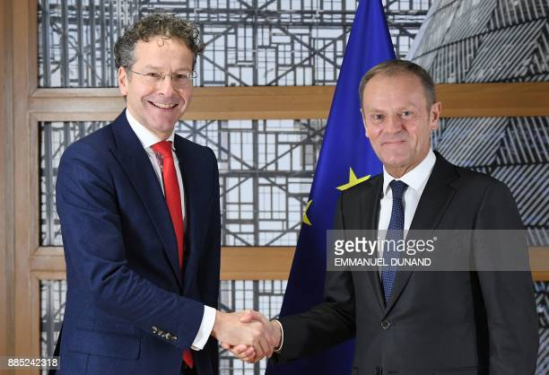 Eurogroup President Jeroen Dijsselbloem shakes hands with European Council President Donald Tusk on December 4 2017 at the European Council in...