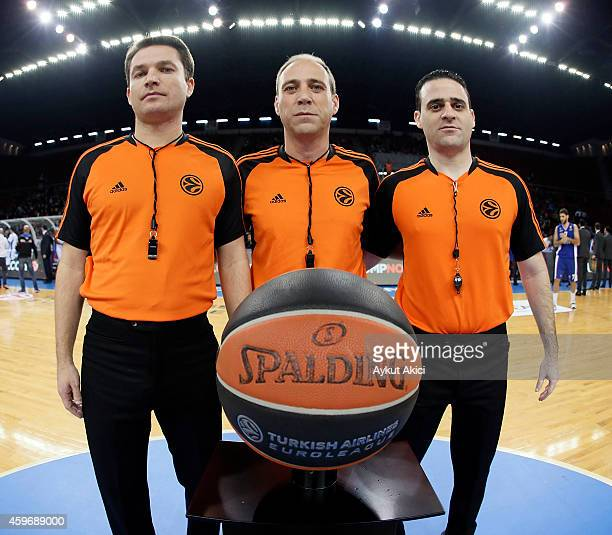 Euroleague referees in action during the 20142015 Turkish Airlines Euroleague Basketball Regular Season Date 7 game between Anadolu Efes Istanbul v...