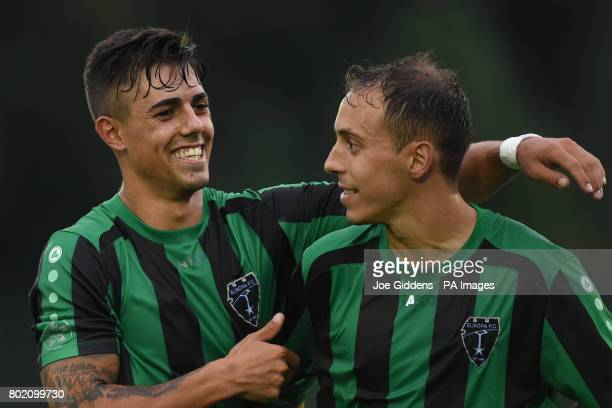 Europa FC's Kike and Toni Garcia celebrate victory after the UEFA Champions League first qualifying round first leg match at Park Hall Stadium...