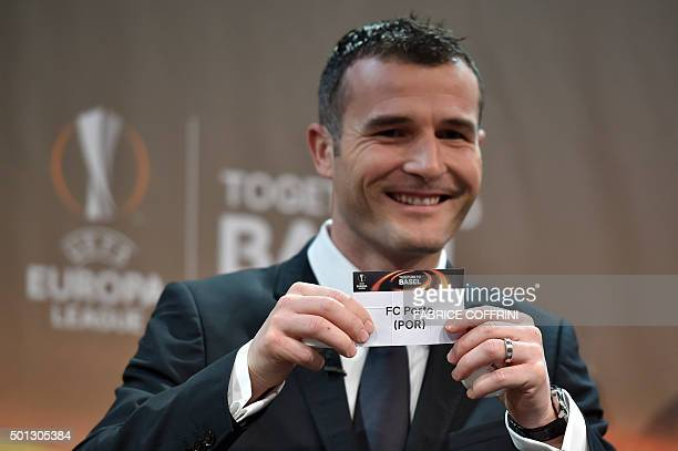 Europa League final ambassador Alexander Frei shows the name of FC Porto football club during the draw for the UEFA Europa league round of sixteen on...