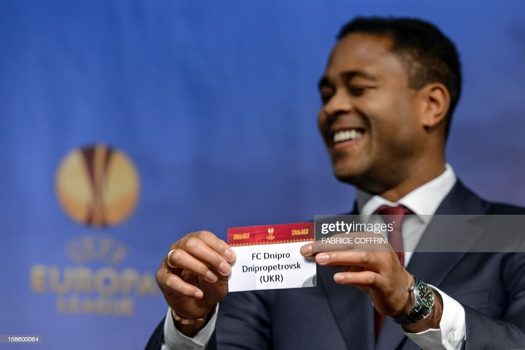Europa League final ambassador Dutch Patrick Kluivert shows the name of Ukraine's Dnipropetrovsk that will play against Swiss FC Basel during the draw for the round of 32 of the UEFA Europa League on December 20, 2012 at the UEFA headquarters in Nyon.