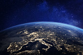 Europe at night viewed from space with city lights showing human activity in Germany, France, Spain, Italy and other countries, 3d rendering of planet Earth, elements from NASA (https://eoimages.gsfc.