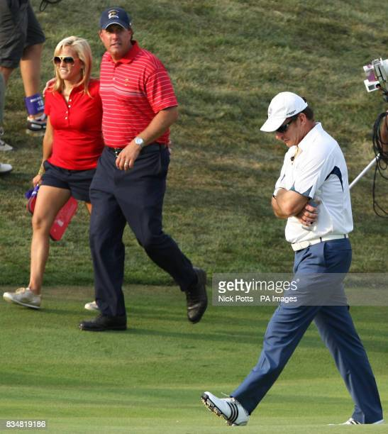 Europe Captain Nick Faldo shows his dejection after acknowledging defeat in the 37th Ryder Cup watched by USA's Phil Mickelson on the 17th green at...