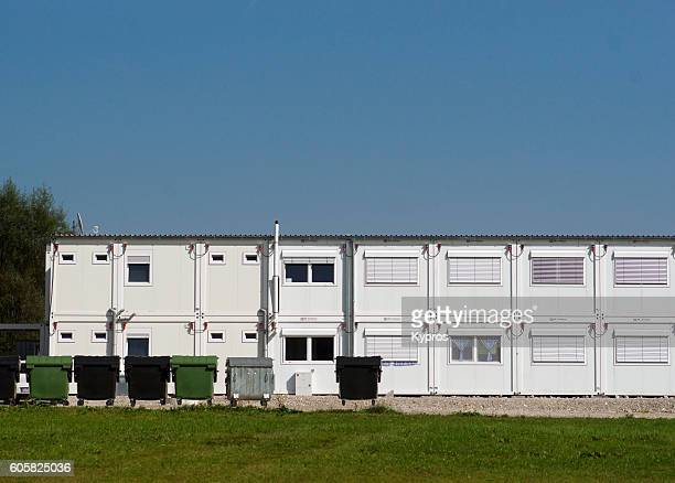 Europe, Germany, Bavaria, Bad Aibling, View Of Shipping Container Migrant Housing (In The Middle Of A Village With Million Euro Homes The Residential Modules Experienced An Arson Attack Almost Immediately.
